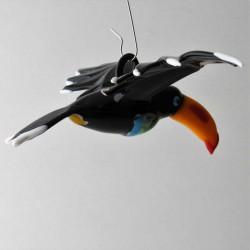 Glas Tukan  fliegend zum...